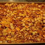 Chex Mix right out of the oven and cooling