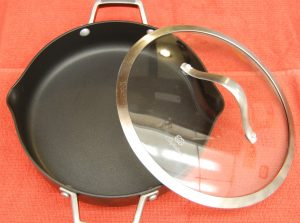 A ten inch non stick skillet with lid.  A must have in the kitchen