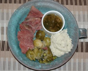 A spin on Jigs Dinner including corn beef, Brussel sprouts and peas, herb mash potatoes, au jus