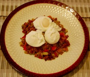 Home made corn beef has and poached eggs.