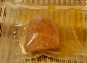Freeze corn beef with some liquid in a container or vacuum seal bag