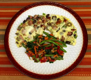 Ham and olive frittata with mixed vegetables.