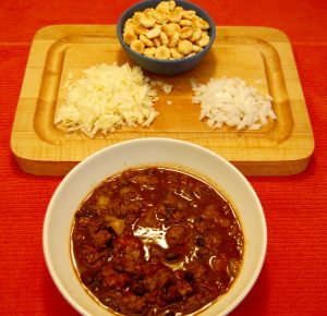 Small batch chili with a variety of toppings