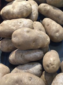 "Loose bake potatoes. Most in the store are ""No. Two"" which is about 10 oz/potatoe"