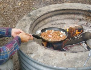 Many camp sites have built in fire pits, making dinner much easier