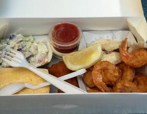 Lunch at the Star Fish Co. Fried gulf shrimp, sautéed grouper, cheese grits, hush puppies and Cole slaw.