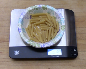 Measure pasta by weight instead of by the cup  or circumference.  A 2 oz portion, dry, is a good starting point
